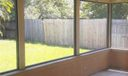 screened patio with 3 ceililng fans