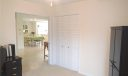 Your light and bright third bedroom/office offers closet space and easy access to the other rooms in the home.