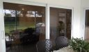 A different view of your covered, screen porch with impact sliders to your living room.