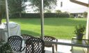 The backyard view from inside your covered, screen porch