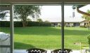 Direct, back view from your covered, screen porch and patio