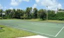 Game on for basketball in this lighted, full court, open area.
