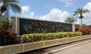 The entrance marquee for Sunset Trace, located directly off Martin Downs Blvd