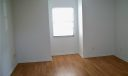 Master bedroom with laminate flooring