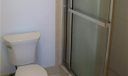 Master bath wit step=in shower with glass sliding doors