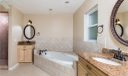 Large Master Bathroom features 2 vanities, tub, walk in shower, linen closet, and privacy door for toilet.