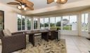 Huge enclosed porch/FL room overlooking lake and pool area.