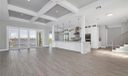 First Floor Open Plan Living/Kitchen/Dining with Breathtaking River Views.  Porcelain Tile Driftwood flooring and coffered ceilings.