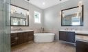 First Floor Master Bath boasts Marble flooring & tile, Soak Tub, His & Her Sinks and Walk-In Shower.