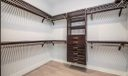 Master Bedroom Walk-In Closet outfitted with John Lewis Home.
