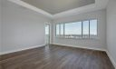 Second Floor Bonus/Media Room with Expansive River Views and access to open patio area.