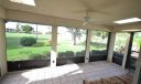 SCREENED IN LANAI WITH VIEWS OF THE 1ST FAIRWAY