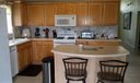 Lots of cabinet and counter space. Lovely tile backsplash. Newer appliances. Nice island for food prep or informal eating.