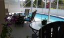 """Wonderful outdoor living--current owners have this set up as a """"man cave"""" (t.v., refrigerator, etc.) A great place to entertain!"""