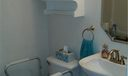 Downstairs half bath is conveniently located near family room and kitchen.