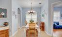 Dining room, light & bright, with beautiful light fixture.
