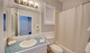 Guest Bath, notice the detail around mirror and window, just beautiful!!!