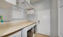 Large laundry room, with storage below counter and above window.