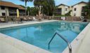 Swimming Pool/Hot Tub/Sauna. Large pool and patio area for residents and guests.