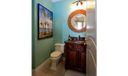 Other. Shabby chic coastal powder room conveniently placed off the office