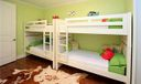 Other. This is a fourth bedroom with marvelous wood floors splashed with fun airy colors.